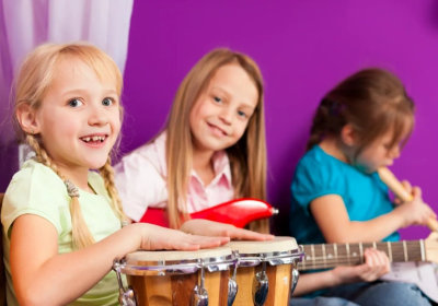 group of children playing musical instruments concept